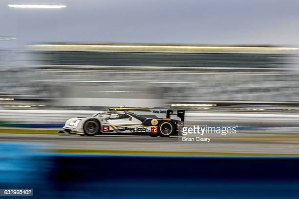 The Cadillac DPi of Joao Barbosa of Portugal Christian Fittipaldi of Brazil and Filipe Albuquerque of Portugal races on the track during the 24 Hours...