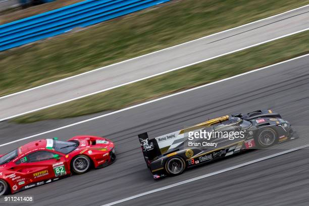 The Cadillac DPi of Joao Barbosa of Portugal Christian Fittipaldi of Brazil and Felipe Albuqureque of Brazil races on the track during the Rolex 24...
