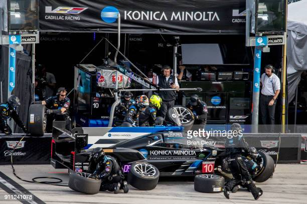 The Cadillac DPi of Jordan Taylor Ryan HunterReay and Renger van der Zande makes a pit stop during the Rolex 24 at Daytona at Daytona International...