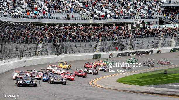 The Cadillac DPi of Jordan Taylor Ryan HunterReay and Renger van der Zande leads the field at the start of the Rolex 24 at Daytona at Daytona...