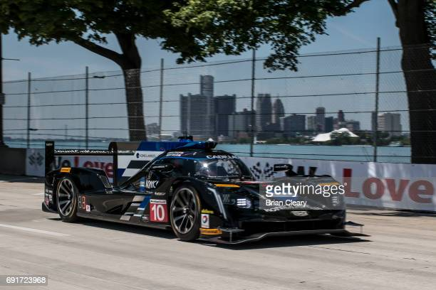 The Cadillac DPi of Ricky Taylor and Jordan Taylor race on the track during practice for the Detroit Grand Prix IMSA WaetherTech Series race at Belle...