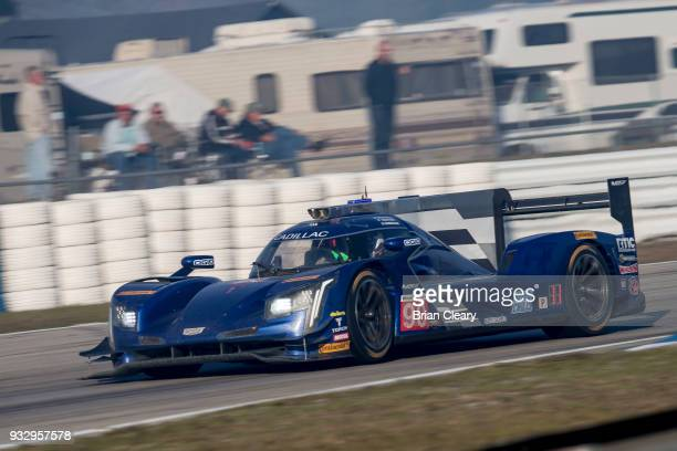 The Cadillac DPi of Tristan Vautier of France Matt McMurray adn Edward Cheever of Italy drives on the track practice for the 66th annual Mobil 1 12...