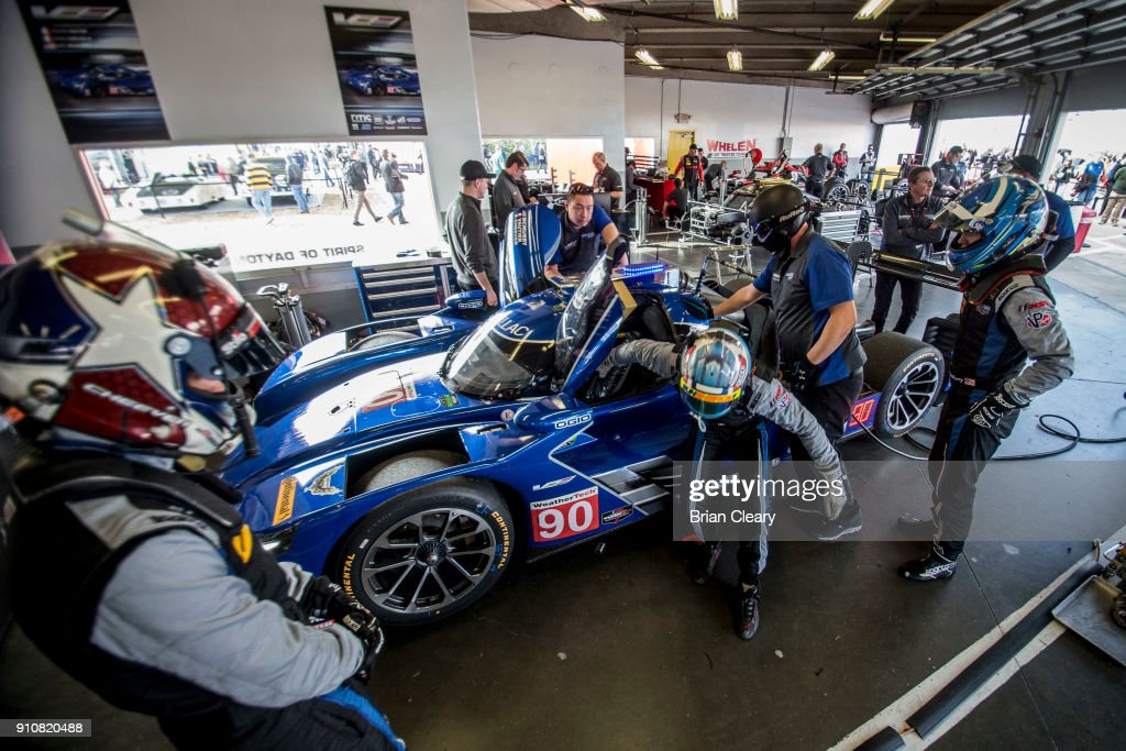 The #90 Cadillac DPi team of Eddie Cheever Jr., Tristan Vautier, of France, and Matt McMurry practices driver changes in the garage before the Rolex 24 at Daytona at Daytona International Speedway on January 26, 2018 in Daytona Beach, Florida.