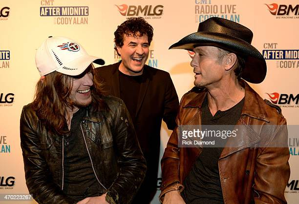 The Cadillac Three's Jaren Johnston Big Machine Label Group President CEO Scott Borchetta and Tim McGraw hang backstage at the 2014 Big Machine Label...