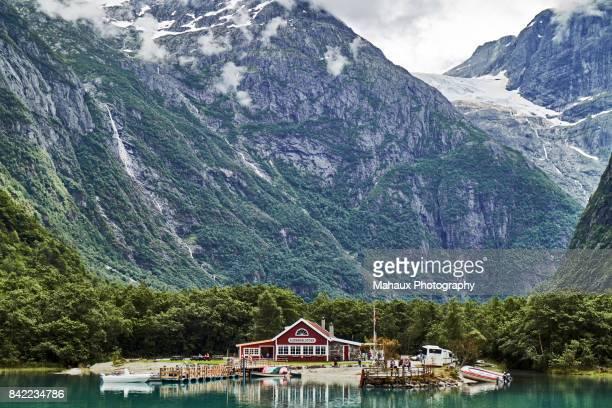the café along the lovatnet loen lake and near the kjenndal glacier - retreating ストックフォトと画像