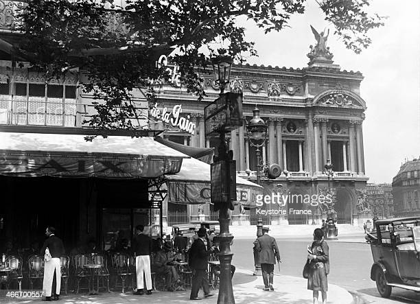 The Cafe de la Paix and the Opera house circa 1920 in Paris France
