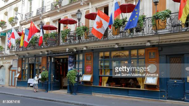 The Cafe Procope in Paris with portraits of famous writers and revolutionary politicians Benjamin Franklin Jean Jacques Rousseau Robespierre Danton...