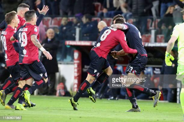 The Cagliari players for the goal scored by Luca Cigarini but is then canceled by the referee during the Serie A match between Cagliari and ACF...