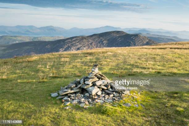 the cairn on y llethr in the early morning;image taken from the cambrian way between the summit of y lethr, which is the highest point in the rhinog mountains, and cwm bychan. august - cambrian stock pictures, royalty-free photos & images