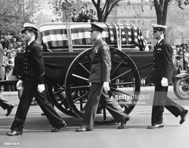 The caisson bearing the body of Franklin Delano Roosevelt proceeds with a military escort up Pennsylvania Avenue to the White House Washington DC...