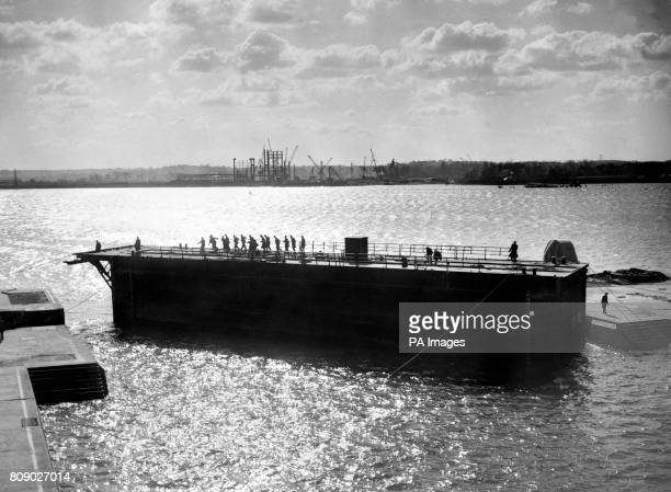 The Caisson or gate which closes the King George V dry docks at Millbrook Southampton so that it can be pumped dry is seen being moved by men hauling...