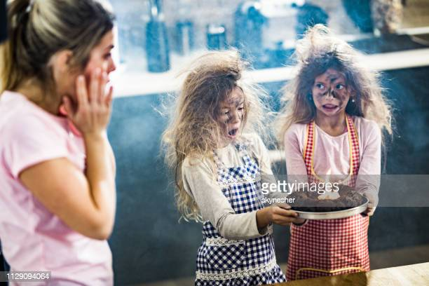 the cake is a little bit burnt mommy! - missing emotion stock pictures, royalty-free photos & images