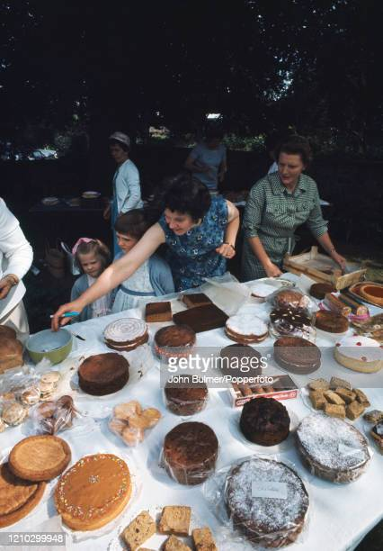 The cake stall and competition at the church fete in the Rectory garden in Pembridge England circa June 1966 During the summer of 1966 British...