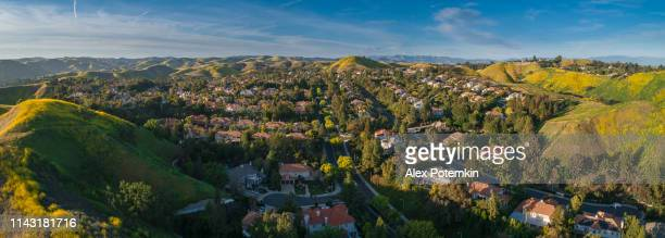 the calabasas city in santa monica mountains, los angeles county, california, usa. aerial extra-wide stitched panorama. - calabasas stock photos and pictures