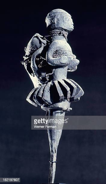The calabash chips forming the skirt of this bocio figure link it to Fa the deity and system of divination Fon religion was directed towards spirits...