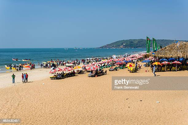 The Calangute Beach with umbrellas blue sky white sand and blue sea is one of the famous beaches in the former Portuguese colony Goa