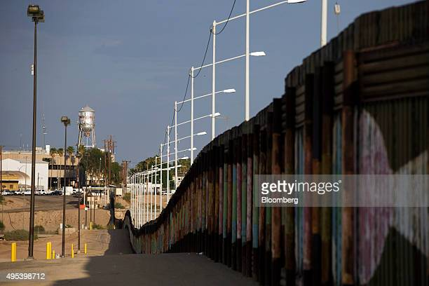 The Calexico water tower stands above the US Border Inspection Station crossing along the border fence in Calexico California US on Monday Oct 12...