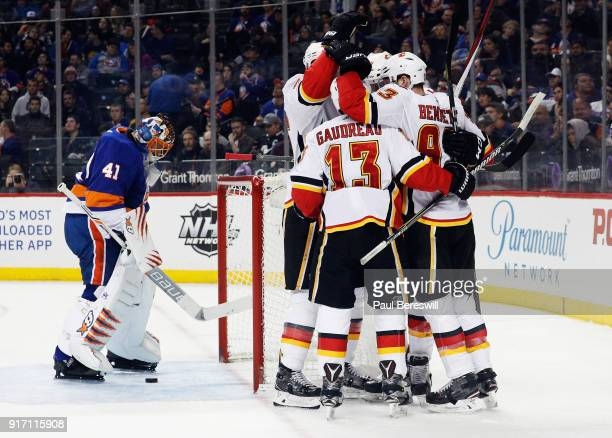 The Calgary Flames celebrate a secondperiod goal by Mark Jankowski against Jaroslav Halak of the New York Islanders at Barclays Center on February 11...