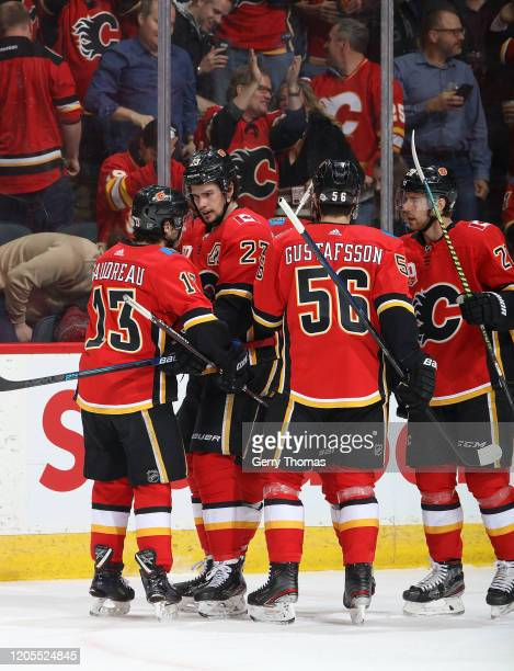 the Calgary Flames celebrate after a goal against the Arizona Coyotes at Scotiabank Saddledome on March 6 2020 in Calgary Alberta Canada