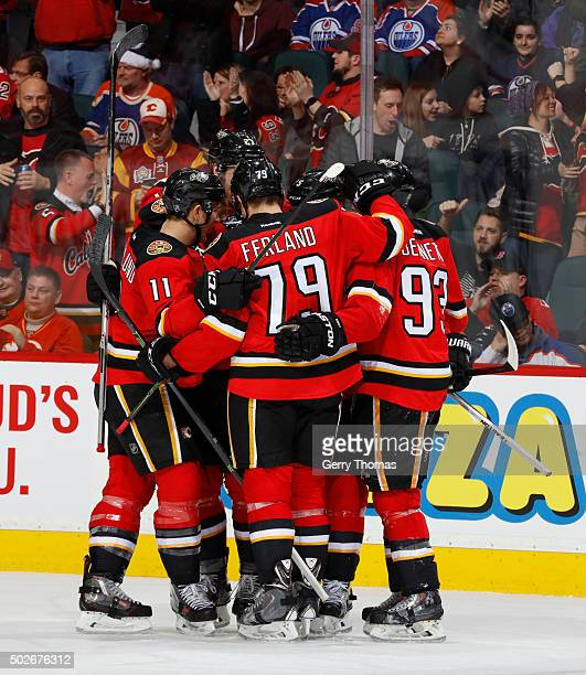The Calgary Flames celebrate after a goal against the Edmonton Oilers at Scotiabank Saddledome on December 27 2015 in Calgary Alberta Canada