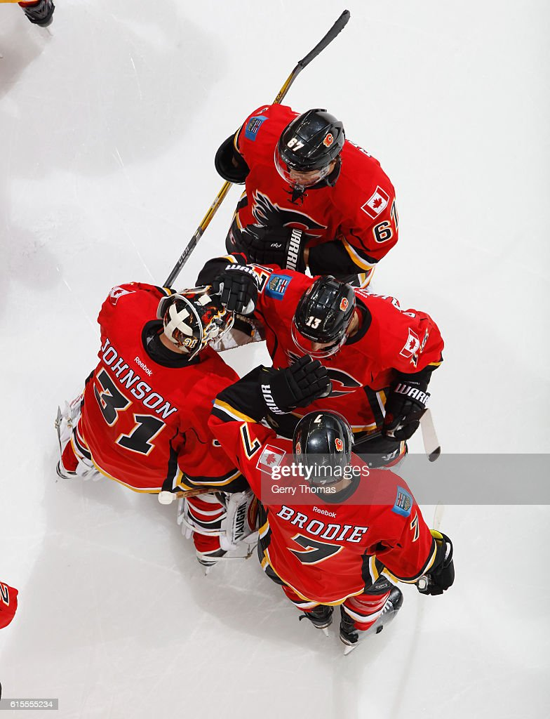 The Calgary Flames celebrate after a win against the Buffalo Sabres at Scotiabank Saddledome on October 18, 2016 in Calgary, Alberta, Canada.