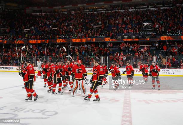 The Calgary Flames celebrate after a win against the New York Islanders at Scotiabank Saddledome on March 5 2017 in Calgary Alberta Canada