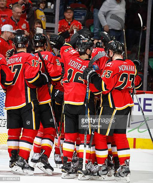 The Calgary Flames celebrate after an OT win against the Nashville Predators at Scotiabank Saddledome on March 9 2016 in Calgary Alberta Canada