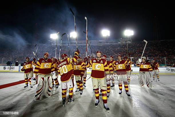 The Calgary Flames celebrate on the ice after they won 40 against the Montreal Canadiens during the 2011 NHL Tim Hortons Heritage Classic at McMahon...
