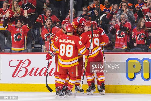 The Calgary Flames celebrate the goal of Elias Lindholm against the Edmonton Oilers during an NHL game at Scotiabank Saddledome on January 11 2020 in...