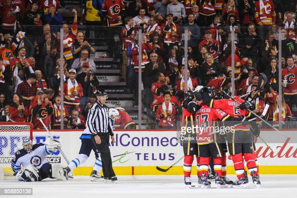 The Calgary Flames celebrate the goal of Micheal Ferland against the Winnipeg Jets during an NHL game at Scotiabank Saddledome on October 7 2017 in...