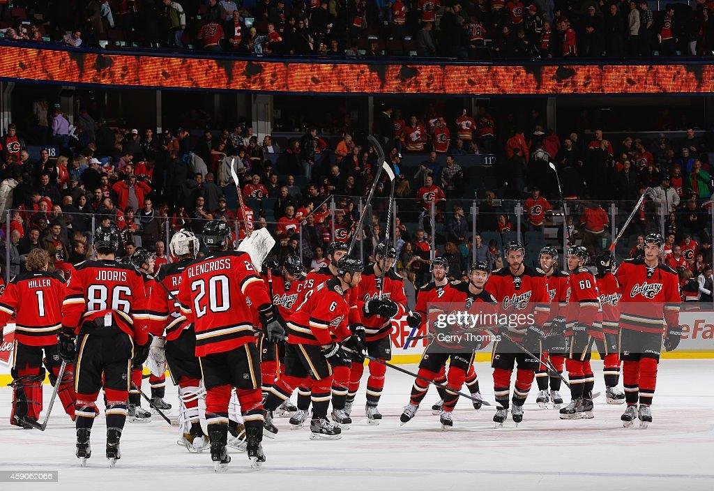 The Calgary Flames celebrate the win against the Ottawa Senators at Scotiabank Saddledome on November 15, 2014 in Calgary, Alberta, Canada.