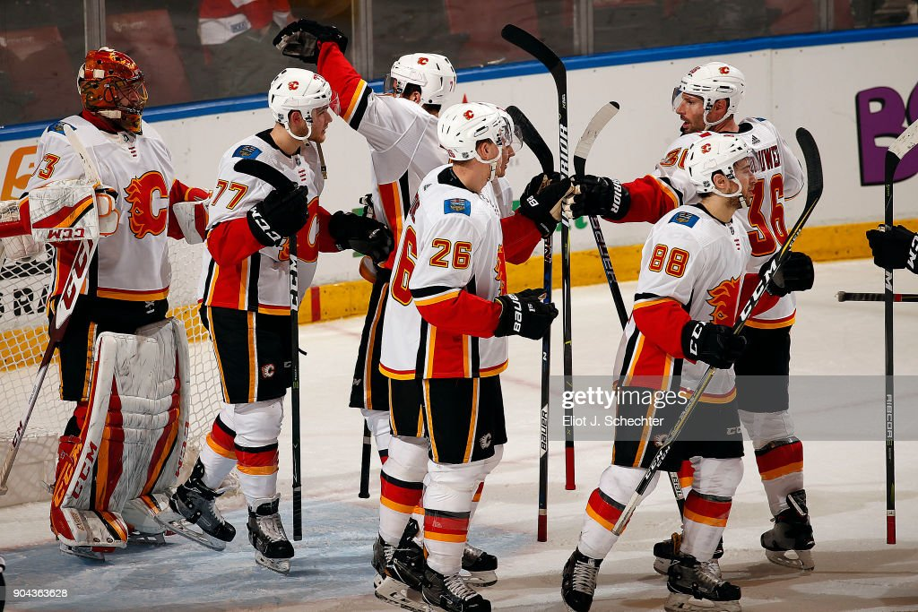 The Calgary Flames celebrate their 4-2 win over the Florida Panthers at the BB&T Center on January 12, 2018 in Sunrise, Florida.