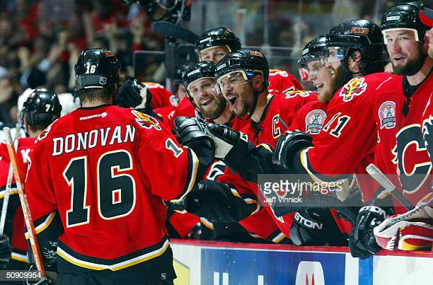 The Calgary Flames congratulate Shean Donovan after scoring the team's second goal against the Tampa Bay Lightning during the second period in game...