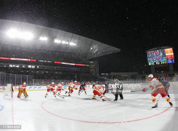 The Calgary Flames face-off against the Winnipeg Jets during the 2019 Tim Hortons NHL Heritage Classic at Mosaic Stadium on October 26, 2019 in...
