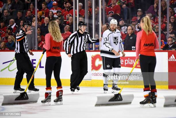 The Calgary Flames ice girls stop shovelling snow as a fight breaks out between Calgary Flames Left Wing Zac Rinaldo and Los Angeles Kings Left Wing...