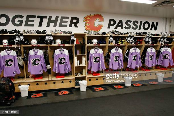 The Calgary Flames locker room is ready with Hockey Fights Cancer jerseys before an NHL game against the New Jersey Devils on November 5 2017 at the...