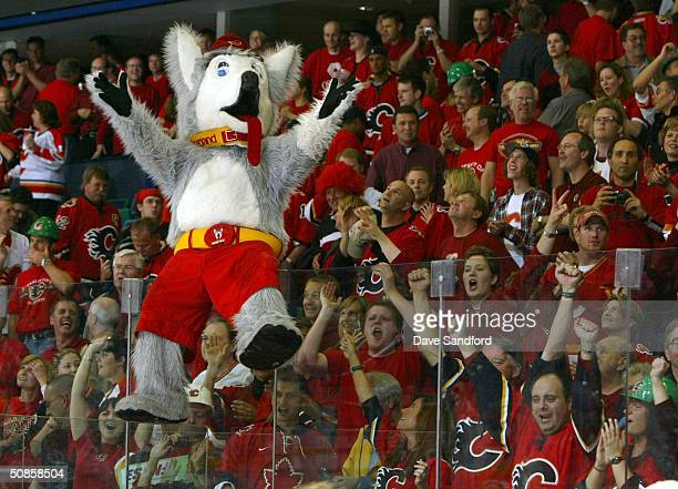 """The Calgary Flames mascot """"Harvey the Hound"""" celebrates with fans after the Flames defeated the San Jose Sharks 3-1 in Game six of the 2004 NHL..."""
