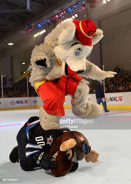 The Calgary Flames mascot Harvey the Hound leap frogs over Winnipeg Jets mascot Mick E Moose during the NHL Mascot Showdown during day two of the...