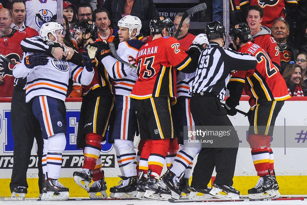 The Calgary Flames mix it up after the whistle with the Edmonton Oilers during an NHL game at Scotiabank Saddledome on March 13, 2018 in Calgary, Alberta, Canada.