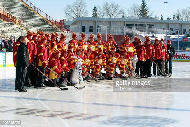 The Calgary Flames pose for a team photo during practice for the 2011 Tim Hortons Heritage Classic at McMahon Stadium on February 19 2011 in Calgary...