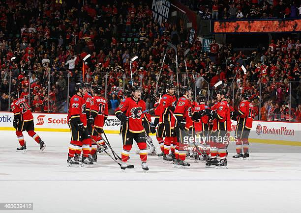 The Calgary Flames salute the crowd after a win against the Boston Bruins at Scotiabank Saddledome on February 16 2015 in Calgary Alberta Canada