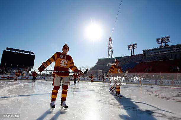 The Calgary Flames skate during practice for the 2011 Tim Hortons Heritage Classic at McMahon Stadium on February 19 2011 in Calgary Alberta Canada