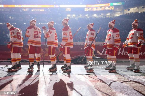 The Calgary Flames walk to the ice before taking on the Winnipeg Jets during the 2019 Tim Hortons NHL Heritage Classic at Mosaic Stadium on October...