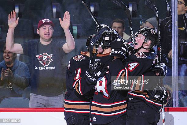 The Calgary Hitmen celebrate after Jordy Stallard scored the gamewinning goal against the Kootenay Ice during a WHL game at Scotiabank Saddledome on...
