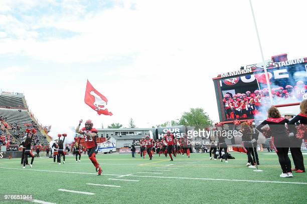The Calgary Stampeders enter McMahon Stadium prior to a CFL game against the Hamilton TigerCats at McMahon Stadium on June 16 2018 in Calgary Alberta...