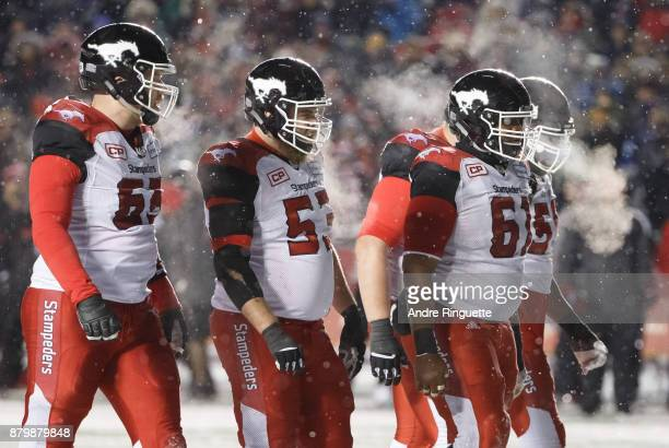 The Calgary Stampeders offensive line walks to the line of scrimmage against the Toronto Argonauts during the second half of the 105th Grey Cup...
