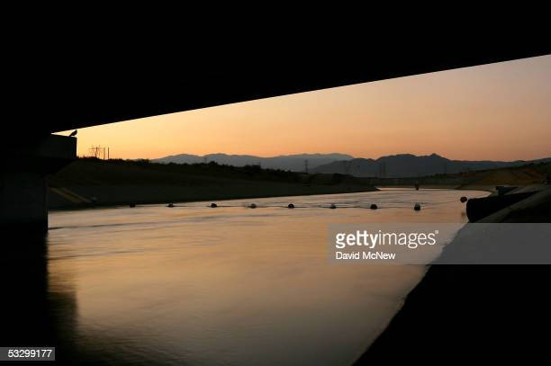 The California Aqueduct which carries water hundreds of miles from northern California to the state's southern cities flows through the desert before...