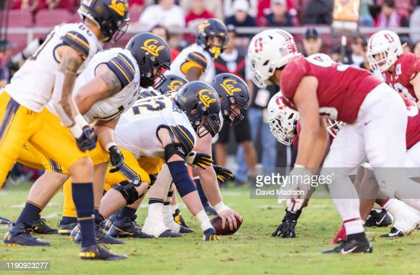 The California Golden Bears and the Stanford Cardinal face off at the line of scrimmage during the 122nd Big Game on November 23, 2019 at Stanford...