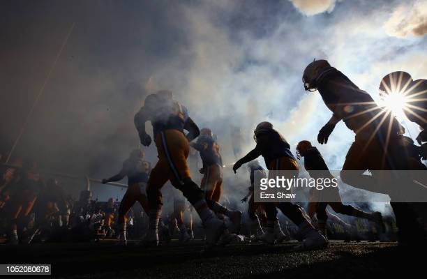 The California Golden Bears run out on to the field for their game against the UCLA Bruins at California Memorial Stadium on October 13, 2018 in...