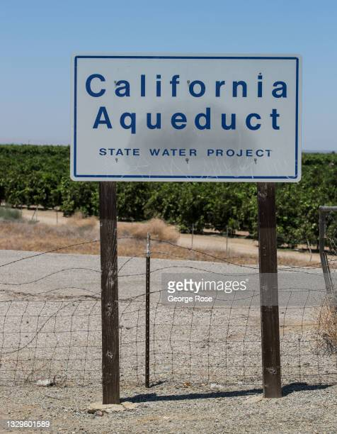 The California State Aqueduct flows under Highway 166 before heading uphill through the Tehachapi Mountains and onto Los Angeles and San Bernardino,...